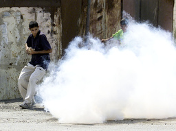 PALESTINIANS FLEE FROM TEARGAS DURING CLASHES IN BETHLEHEM