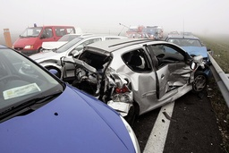 Wrecked cars lay at scene after collision in heavy fog involving more than fifty vehicles where some twenty-two people were injured on French motorway in direction of Bordeaux to Bayonne, southwestern France