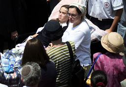 DAUGHTER WOUNDED IN BLAST ATTENDS FAMILY FUNERAL IN JERUSALEM