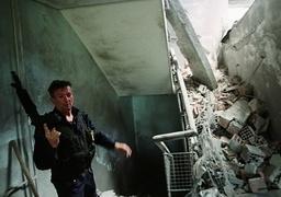 PRISON GUARD INSIDE PRISON DESTROYED IN NATO AIRSTRIKES IN KOSOVO