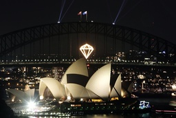 A pyrotechnic display in the shape of a diamond glows on the Sydney Harbour Bridge during New Years eve celebrations