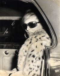 Actress Ursula Andress Wearing Leopard Skin Fur Coat And Sunglasses.