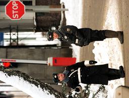 RUSSIAN POLICEMAN STOPS A CAR OUTSIDE YELTSIN SANATORIUM