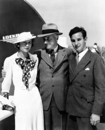 Cecil B. DeMille, center, with son John DeMille and John's fiancee, Louise Denker, September 26, 193
