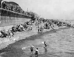 Holiday Makers On The Beach At Hastings.