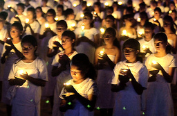 EAST TIMORESE GIRLS HOLD CANDLES DURING A MASS PRAYER SERVICE IN TACITOLU