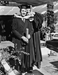 Walt Disney is awarded a doctorate by Rufus B. Kleinsmid, 1938