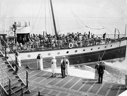 A Boat Load Of Holiday Makers Arrive At Hastings Pier.