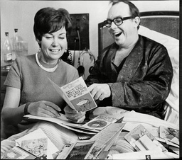Eric Morecambe Comedian In Hospital Bed Recovering From Heart Attack Reading Get Well Cards With Wife Joan Morecambe 1968.