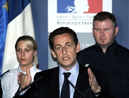 French Interior Minister Sarkozy delivers a speech as he visits Marseille's Central police station