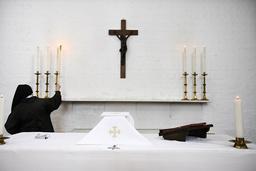 Nun preparing a religious service