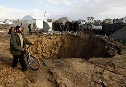 Palestinian man walks past destroyed tunnel near Egyptian border with Gaza Strip