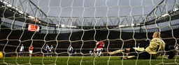 Arsenal's Adebayor scores a penalty during their English Premier League soccer match in London