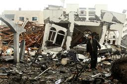 Palestinian man surveys ruins of destroyed office in Gaza
