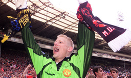 MANCHESTER'S SCHMEICHEL LIFTS THE F.A. CUP TROPHY AT WEMBLEY