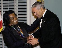 File photo of singer Brown and US Secretary of State Powell in Washington