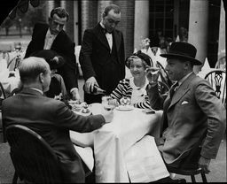 Actor Sir Cedric Hardwicke And Lady Hardwicke On The Right At Family Party They Gave Outside The Restaurant Pavilion In Kensington Gardens
