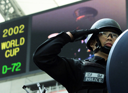 A POLICE OFFICER SALUTES DURING THE LAUNCH OF A SPECIAL UNIT AT SEOUL WORLD CUP STADIUM