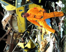 A PILOT STANDS BY HIS PLANE'S WRECKAGE IN PERTH
