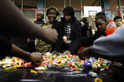 Homeless people attend New Year's Eve celebrations at the Saint-Merri gymnasium in Paris, five days after more than 100 people who were living in poor housing conditions took shelter there