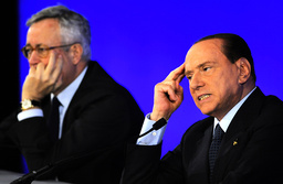 Italy's Prime Minister Berlusconi gestures during a news conference with Italian Finance Minister Tremonti at the end of the G20 Summit in Cannes