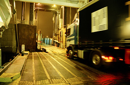 Truck and ferry at night