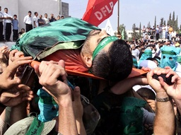 PALESTINIANS CARRY THE BODY OF ABDEL RAHMAN HAMAD IN QAQILYA