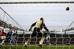 Arsenal's Gilberto scores a goal during their English Premier League soccer match at The Emirates Stadium in London