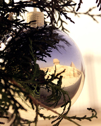 THE IMAGE OF THE 4,500-YEAR-OLD SPHINX IS REFLECTED ON A CHRISTMAS ORNAMENT IN CAIRO.
