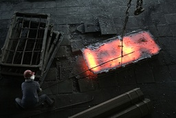 A labourer works at a ferroalloy factory on the outskirts of Xining