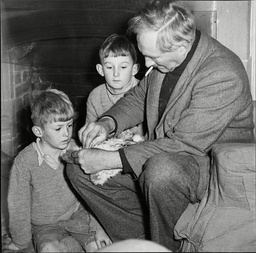 Anthropologist Dr Louis Leakey (died 9/72) Demonstrating How Mesolithic Man Used A Flint Scraper To Sons John And Richard.