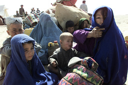 A FAMILY OF NEWLY ARRIVED AFGHAN REFUGEES RESTS AT A NEW REFUGEE CAMP NEAR THE CHAMAN BORDER CROSSING