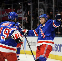New York Rangers Markus Naslund celebrates his goal against the Colorado Avalanche with Scott Gomez in their NHL hockey game in New York
