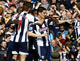 West Bromwich Albion's Dorrans celebrates his goal against Cardiff City with team mates during their English Premier League soccer match in West Bromwich