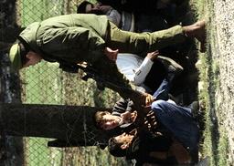 ISRAELI ARMY OFFICER KICKS A PALESTINIAN TEENAGER AT EL AROUB