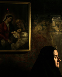 Nun stands in grotto, where Christians believe Virgin Mary gave birth to Jesus, in Church of Nativity Bethlehem