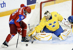 Sweden's Markstrom stops a scoring attempt by Russia's Kugryshev at the IIHF U20 World Junior Hockey Championships in Ottawa