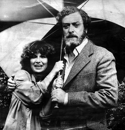 Julie Walters Actress And Michael Cain Actor Huddle Together Under A Large Umbrella After Rain Stopped Filming Of The Highly Successful Movie Educating Rita.