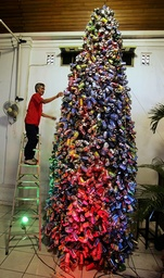 Man adds finishing touches to Christmas tree made out of 6000 used cans at a church in Jakarta