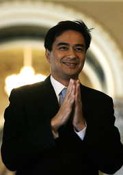 Thai Prime Minister Abhisit Vejjajiva greets before an interview at the government house in Bangkok