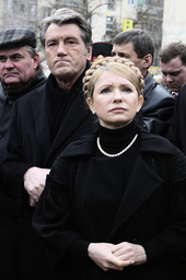Ukraine's Prime Minister Yulia Tymoshenko (R) and President Viktor Yushchenko visit the shattered five-storey block in the Black Sea resort of Yevpatoria