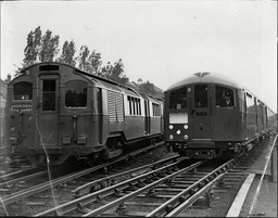 New London Transport Tube Train On The Right Along Side Old Type Train On The Left At Golders Green Depot.