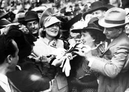 Marlene Dietrich gives autographs, 1939