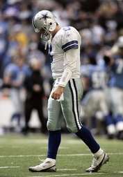 Dallas Cowboys quarterback Tony Romo walks off the field after failing to score on fourth down in Irving