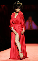 File photo of Eartha Kitt posing on runway during Heart Truth Red Dress fashion show in New York
