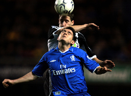 CHELSEA'S LAMPARD IS TACKLED BY NEWCASTLE UNITED'S ELLIOT