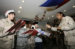 U.S. soldiers sing during a Christmas celebration at the U.S. embassy in Baghdad