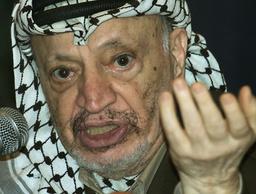 PALESTINIAN PRESIDENT YASSER ARAFAT ADDRESSES JOURNALISTS IN THE WEST BANK CITY OF RAMALLAH