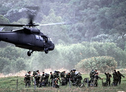 COLOMBIAN ARMY HELICOPTER LANDS NEAR A COMBAT ZONE