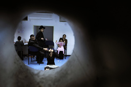 Israelis sit in a bomb shelter in Ashkelon